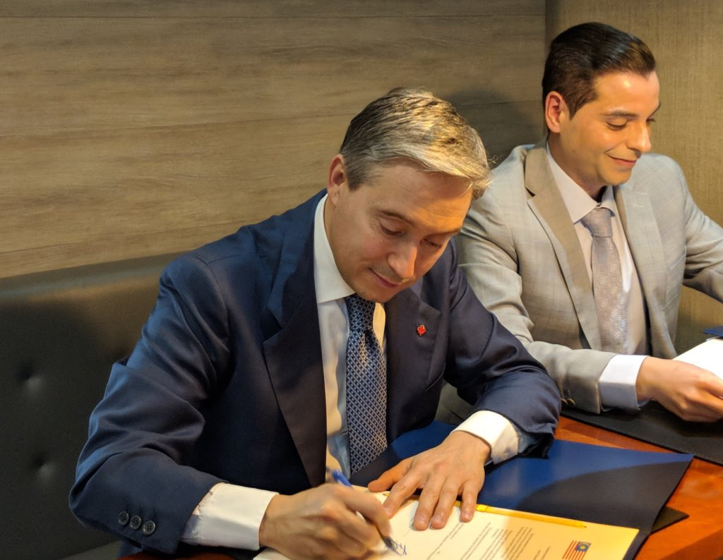 The Honourable François-Philippe Champagne, Minister of International Trade, signing the CPTPP on March 8, 2018